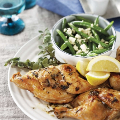 Greek lemon spatchcock chicken with beans and feta Recipe